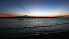 Sunset view on Gili Trawangan and Bali. Sunset view from gili meno to gili trawangan and bali volcano Stock Image