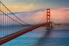 Sunset view of the Golden Gate Bridge and fog   Stock Images