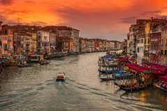Sunset view of Grand Canal with gondolas in Venice Stock Images