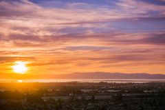Sunset view of Hayward and Union City. From Garin Dry Creek Pioneer Regional Park, east San Francisco bay shoreline and San Mateo bridge in the background Stock Image