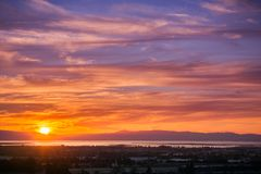 Sunset view of Hayward and Union City. From Garin Dry Creek Pioneer Regional Park, east San Francisco bay shoreline and San Mateo bridge in the background royalty free stock images
