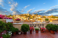 Sunset view of the historic quarter Albaicin and Alhambra from the balcony of the building Stock Photos