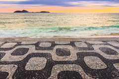 Sunset view of Ipanema beach with mosaic of sidewalk in Rio de Janeiro Stock Image