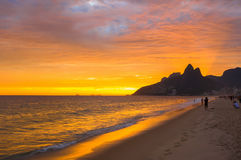 Sunset view of Ipanema beach and mountain Dois Irmao (Two Brother) in Rio de Janeiro Stock Photos