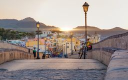 Sunset view Ischia street with colourful houses, Italy Stock Image