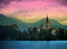 Sunset view of Julian Alps, Lake Bled with St. Marys Church of the Assumption on the small island; Bled, Slovenia, Europe Stock Images