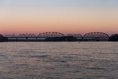 Sunset at Kentucky & Indiana Terminal Railroad Bridge - Ohio River, Louisville, Kentucky & Jeffersonville, Indiana. An sunset view of the Kentucky & Indiana stock image