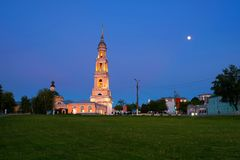 Sunset view of Kolomna, Russia at night with a cathedral and car traffic Stock Photography