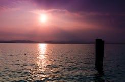 Lake Garda. Sunset view of Lake Garda from dock at Sirmione Italy stock photos