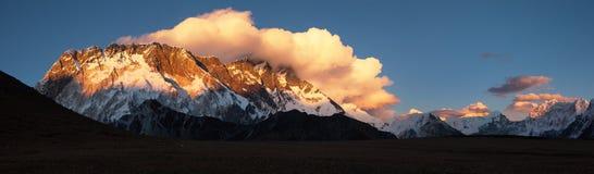 Sunset view of Lhotse, Nepal Himalayas mountains. Evening sunset view of Lhotse, Nuptse and clouds on the top,warm tone - way to mount Everest base camp, khumbu Royalty Free Stock Photos