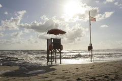 Sunset view of a lifeguard tower at sunset time in Versilia Stock Image
