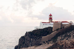 Sunset and a view of the lighthouse at Cape St. Vincent. Portugal. Region Algarve Royalty Free Stock Image