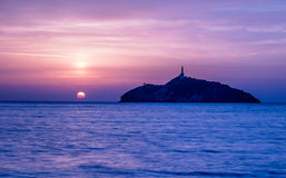 Sunset view of a lighthouse in an island - Santa Marta, Colombia Stock Photos