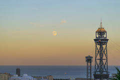 Sunset view with lighthouse and moon Stock Image