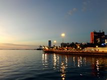 The sunset view of water front city of Makassar, Indonesia stock photography