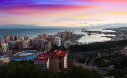 Sunset view of Malaga with Port and Placa de Torros Stock Photography