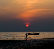 Romantic sunset view with a man walking. Beautiful sunset view with a man walking around the seashore background photograph stock photography