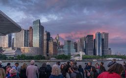Sunset View of Manhattan skyline from cruise. New York, NY, USA - June 4, 2018. People on the cruise enjoy sunset view of lower Manhattan skyline Royalty Free Stock Photos