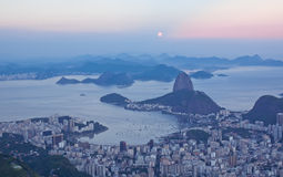 Sunset view of mountain Sugar Loaf and Botafogo in Rio de Janeiro Stock Images
