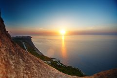 Sunset view from mountaintop. Tourism, travel, sea background. Sunset view from mountaintop. Tourism, travel sea background Stock Images