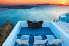 Sunset View of Nea Kameni Island in Santorini, Greece Stock Photo