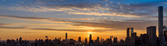 Sunset view of New York City skyline. Over looking Central Park in Manhattan with high rise alone the fifth Ave and beyond Royalty Free Stock Images