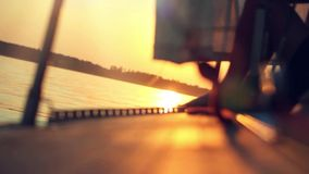 Sunset view from nose of yacht and sun reflected stock footage
