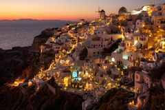 Sunset view of Oia town on Santorini in Greece Stock Images