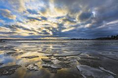 Sunset over ice floes royalty free stock image