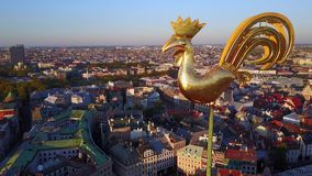 Aerial View of the Sunset Over Riga Old Town. Sunset view over the old town of Riga - Vecriga with golden rooster in the foreground stock video footage