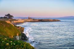 Sunset view of the Pacific Ocean rugged coastline, Santa Cruz, California. Santa Cruz surfing museum in the background stock photos