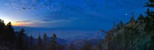 Sunset view from the Palm Springs Aerial Tramway towards Coachella Valley. Simultaneous sunset and moonrise, view from the Palm Springs Aerial Tramway towards stock photography