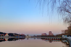 Sunset view of the park in Tianjin, China. In spring, the temperature rose, the city park is a good place for people at leisure Royalty Free Stock Photos