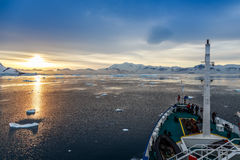 Sunset view and people gathered on the deck, Icebergs drifting royalty free stock photo