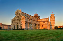 Sunset view of Pisa Cathedral Duomo di Pisa with the Leaning Tower of Pisa Torre di Pisa on Piazza dei Miracoli in Pisa, Tusca Royalty Free Stock Photo