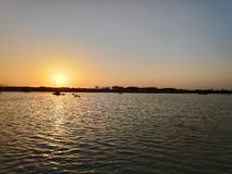 Sunset view and pleasing sounds of water. royalty free stock image