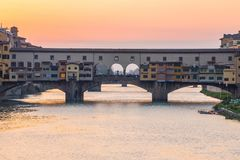 Sunset view at Ponte Vecchio bridge in Florence, Tuscany, Italy.  Stock Photo