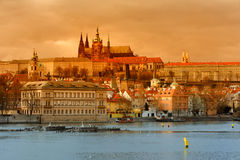 Sunset View of The Prague Castle over Vltava Stock Photos