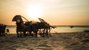 Sunset view of pub table and chairs on african beach, timelapse stock video footage