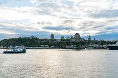 Sunset view of the Quebec city skyline with Fairmont Le Château Frontenac, ferry royalty free stock images