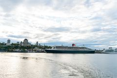 Sunset view of the Quebec city skyline with Fairmont Le Château Frontenac, Queen Mary 2 royalty free stock photos