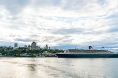 Sunset view of the Quebec city skyline with Fairmont Le Château Frontenac, Queen Mary 2 stock photography