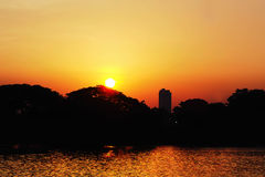 Sunset view and river. In the evening city Stock Images