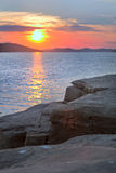Sunset view from a rock. By the sea Stock Photo