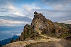 Sunset view of rocky mountain peak on the hiking path Pico Arieiro. Royalty Free Stock Image