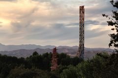 Sunset view of a roller coaster and the hills in California stock image