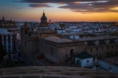 A sunset view of the rooftops of Seville taken from the Metropol Parasol, looking out towards the main catherdral. stock photos