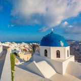 Sunset view of Santorini blue dome churches Royalty Free Stock Image