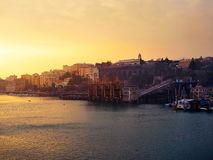Sunset view of Savona, Italy. Sunset view with sea foreground of Savona, Liguria, Italy, Europe Royalty Free Stock Photography