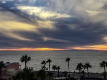 Sunset View of the Sea of Cortez. Guf of California, Sonora, Mexico with grey and blue sky and white clouds stock photos